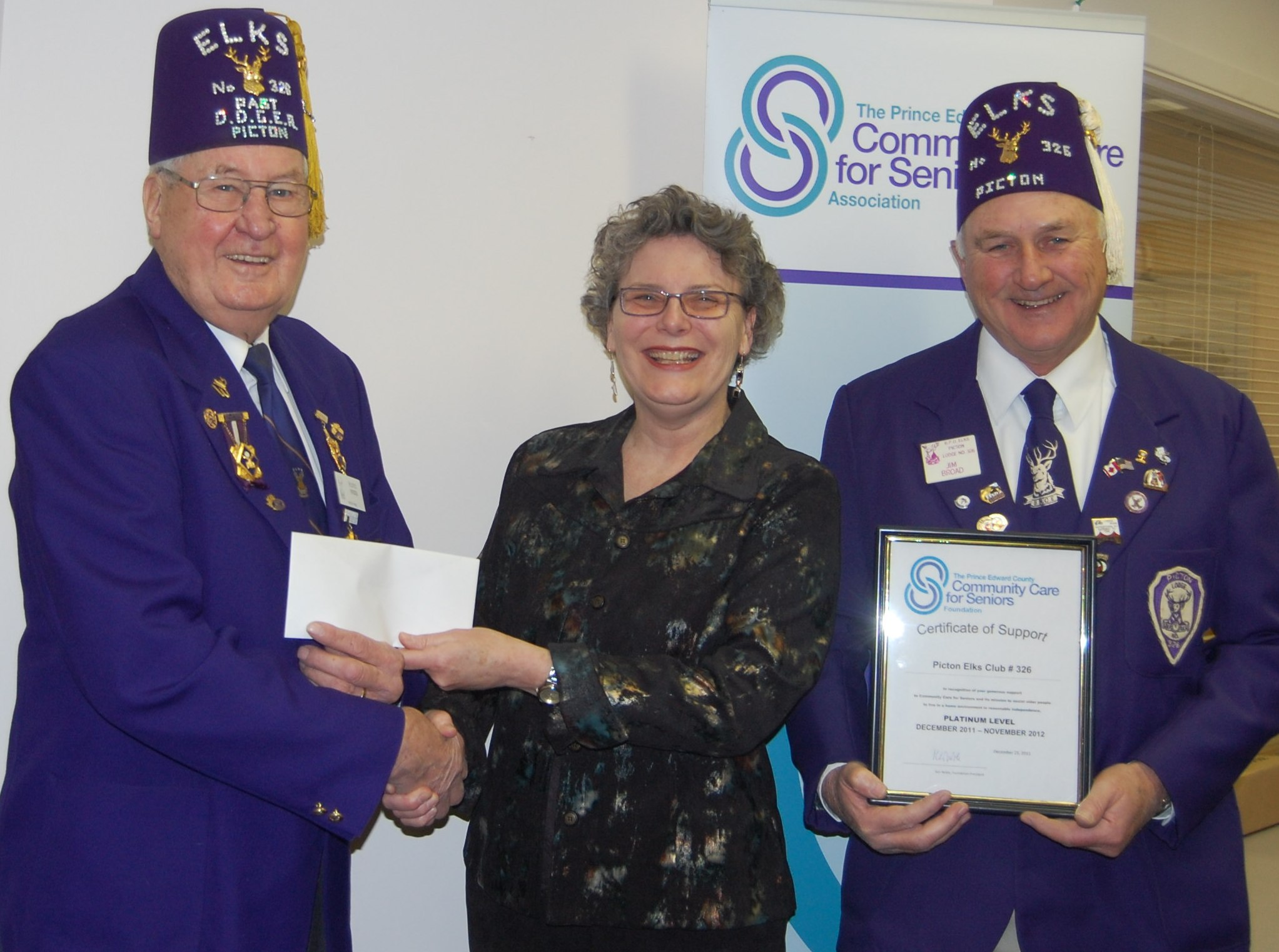 Elks Lodge finance committee presents cheque