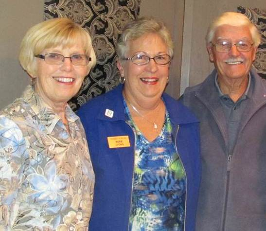 L-R: Laura Demers, choir director; Barbara Lyons, member of the choir and Past President of Community Care; Mervyn Hicks, member of the choir