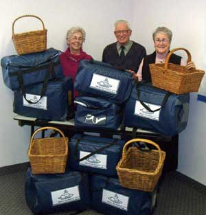Meals on Wheels volunteers (L-R) Edith Morash, Stan Whitehouse and Maureen Finnega n with the new delivery containers.