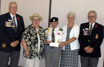 L-R Doug Pitt, Poppy Fund Treasurer; Genny Vincent, Community Care board chair; Don Istead, Poppy Fund Chair; Betty Lee, Community Care; Ted Taylor, President of Branch 78, Royal Canadian Legion in Picton.