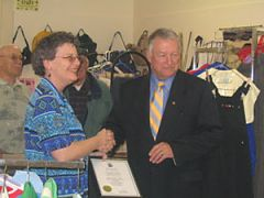 Debbie MacDonald Moynes accepts a certificate from Mayor Leo Finnegan