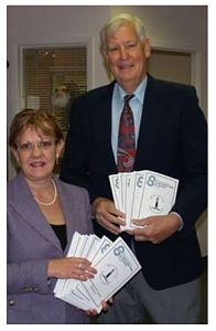 Wendy Davis, President of Hospice Prince Edward and Ken Noble, chair of the board of Prince Edward Community Care with the new Information for Seniors Directory that is available free to seniors in The County.